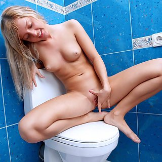 Kadence getting her hands busy down under inside the toilet